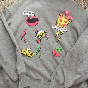 cropped sweater with puffy appliqués